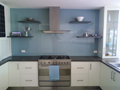 'Floating' 2pak painted shelves on glass splashback