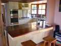 Timber veneer kitchen with stainless steel & solid timber benchtops