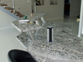 Granite benchtop with upstand and lift-up powerpoints