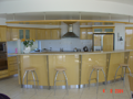 Silver Ash veneer kitchen with timber veneer light bulkhead