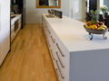 White kitchen with Ceasarstone benchtops and glass splash