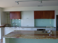 2Pak & veneer kitchen with back-lit glass splashbacks & onyx benchtop